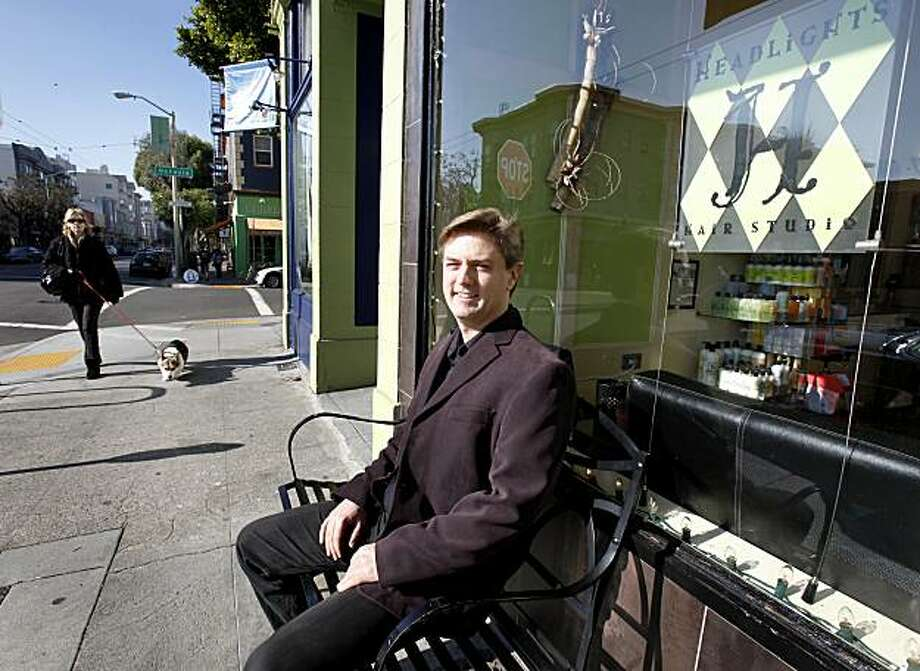 After his haircut, West sits on a bench in front of the salon. San Francisco Ballet conductor Martin West likes the haircuts he gets from Joseph Brabant at the Headlights Hair Salon at 494 Hayes Street in San Francisco, CA. Photo: Brant Ward, The Chronicle