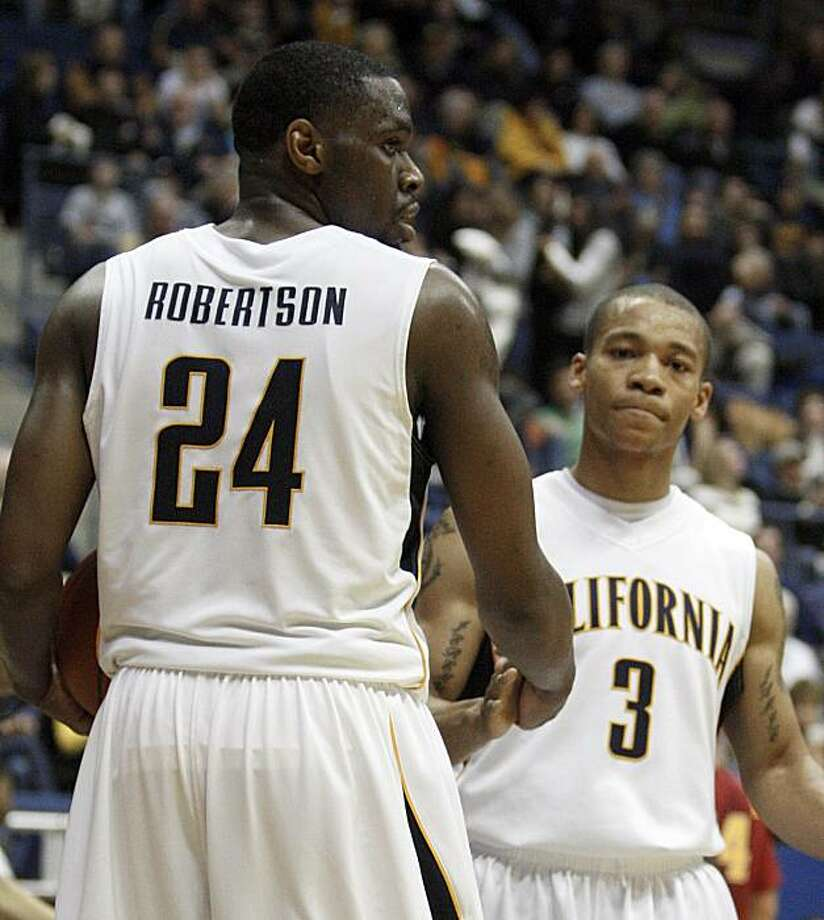 California's Theo Robertson (24) and Jerome Randle (3) congratulate each other at the end of an NCAA college basketball game against Southern California, Saturday, Jan. 9, 2010, in Berkeley, Calif. Photo: Ben Margot, AP