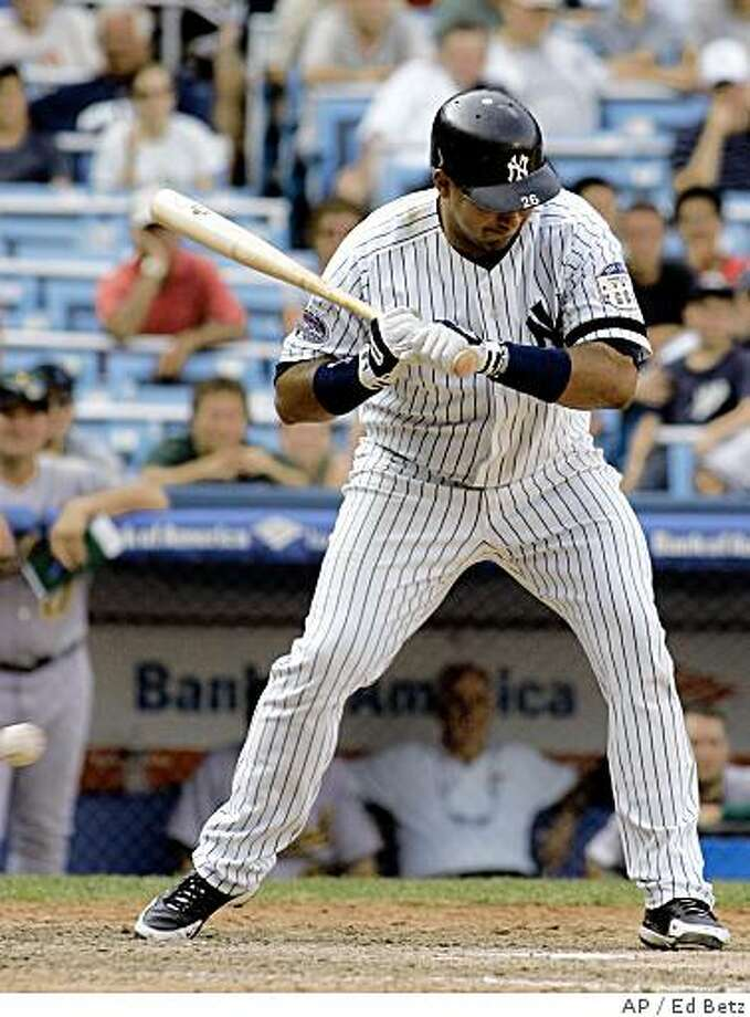 New York Yankees' Jose Molina is hit by a pitch with the bases loaded against the Oakland Athletics during the 12th inning of their baseball game at Yankee Stadium in New York, Saturday, July 19, 2008. The Yankees defeated the Athletics 4-3. (AP Photo/Ed Betz) Photo: Ed Betz, AP