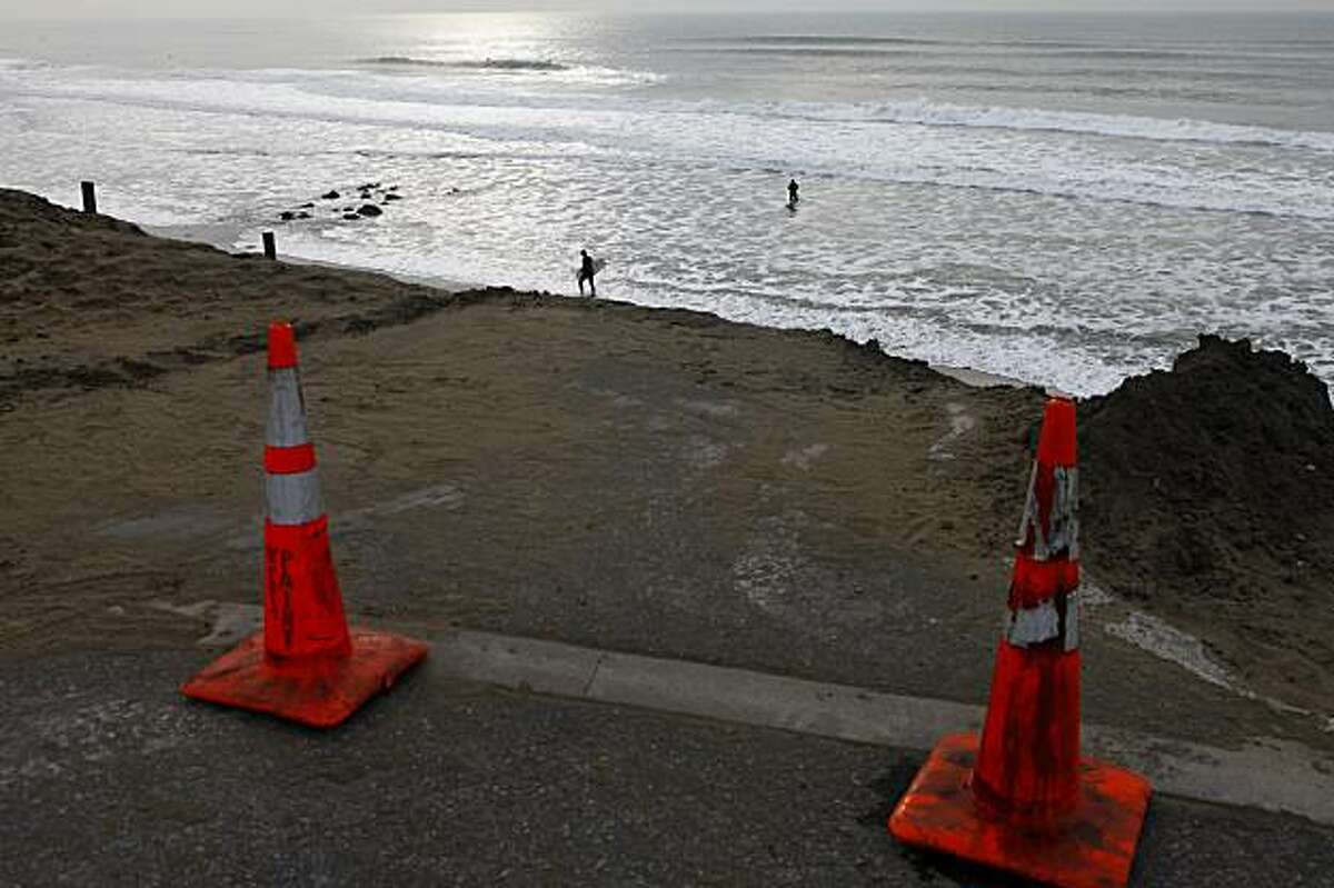 Orange cones and barriers have been placed along the erosion on the Great Highway, for caution, Thursday Jan. 7, 2010, in San Francisco, Calif. The DPW and the National Park Service are continuing to address the erosion just south of Sloat Boulevard, along a 650-foot stretch of coastal bluff, by closing one of the lanes of traffic.
