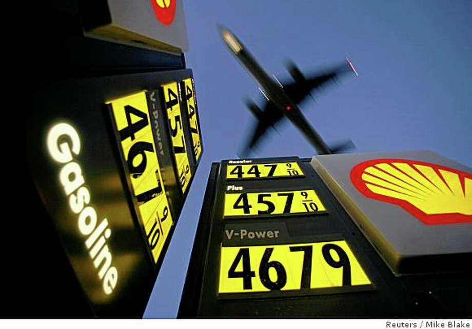 Gasoline prices are advertised at a gas station near Lindbergh Field as a plane approaches to land in San Diego, California in this June 1, 2008 file photo. To match Reuters Witness story OIL/TAXI in which, Daniel Fineren, who is a senior energy correspondent, describes his recent encounter with a Spanish taxi driver on the way home from the World Petroleum Congress. To match Reuters Witness story OIL/TAXI.  REUTERS/Mike Blake (UNITED STATES) Photo: Mike Blake, Reuters