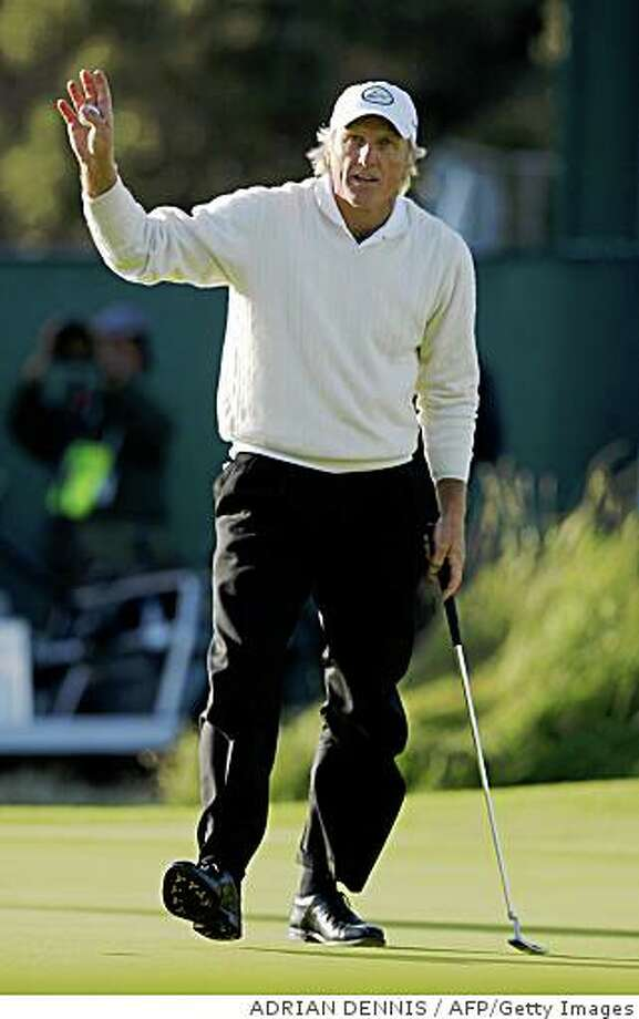 Greg Norman of Australia acknowledges the crowds applause after completing his third round at The Open golf tournament at Royal Birkdale in Southport in north-west England, on July 19, 2008. AFP PHOTO/ADRIAN DENNIS (Photo credit should read ADRIAN DENNIS/AFP/Getty Images) Photo: ADRIAN DENNIS, AFP/Getty Images