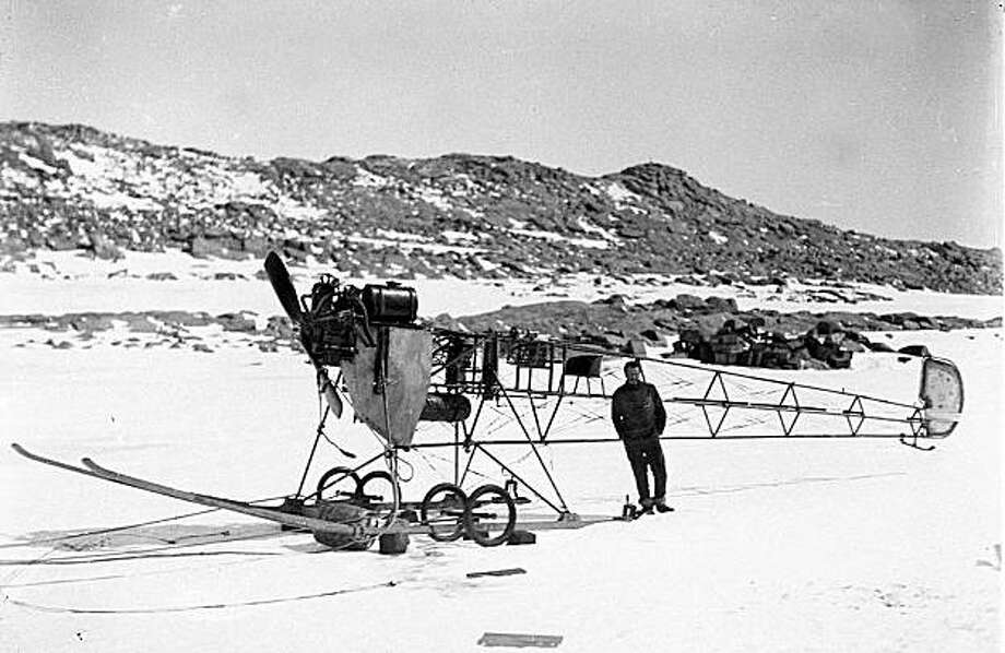 In this 1912 image provided by the Mawson's Huts Foundation, an unidentified man stands next to a Vickers airplane used during an Australian Antarctic Expedition in Antarctica. Remains of the first airplane ever taken to Antarctica have been found by Australian researchers, the team announced Saturday, Jan. 2, 2010. (AP Photo/Mawson's Huts Foundation, Frank Hurley) ** EDITORIAL USE ONLY ** Photo: Frank Hurley, AP