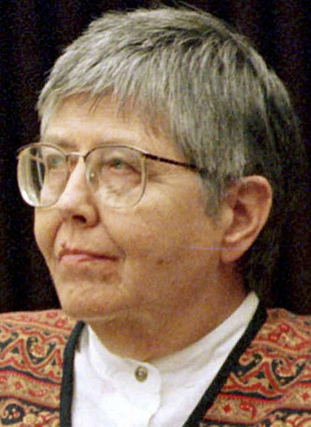 FILE - In this May 24, 1999 file photo, feminist theologian Mary Daly sits in Middlesex Superior Court in Cambridge, Mass. Daly, who retired from a professorship at Boston College rather than allow men to take her classes, died Wednesday, Jan. 6, 2010. She was 81.