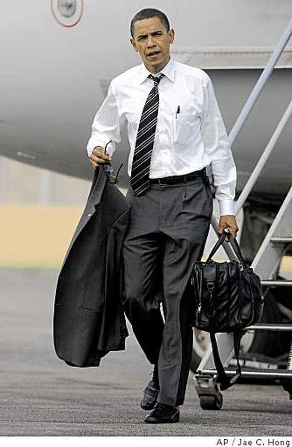 Democratic presidential candidate, Sen. Barack Obama, D-Ill., arrives at Midway International Airport in Chicago, Wednesday, July 16, 2008. (AP Photo/Jae C. Hong) Photo: Jae C. Hong, AP