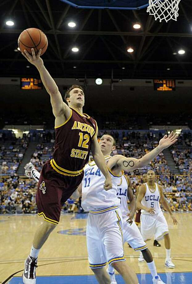 Arizona State's Derek Glasser, left, puts up a shot as UCLA's Reeves Nelson defends during the second half of an NCAA college basketball game, on Thursday, Dec. 31, 2009, in Los Angeles. UCLA won 72-70. (AP Photo/Mark J. Terrill) Photo: Mark J. Terrill, AP