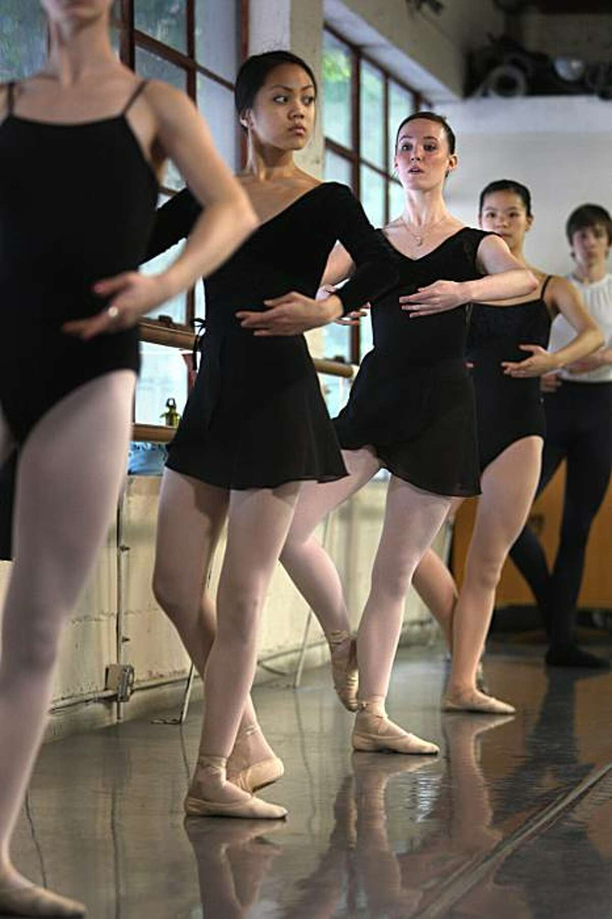 Jeraldine Mendoza (second from left) and Emma Powers (third from left) take a ballet class at the City Ballet School with City Ballet School resident choreographer Yuri Zhukov (not shown) in San Francisco, Calif. on Tuesday January 6, 2010.