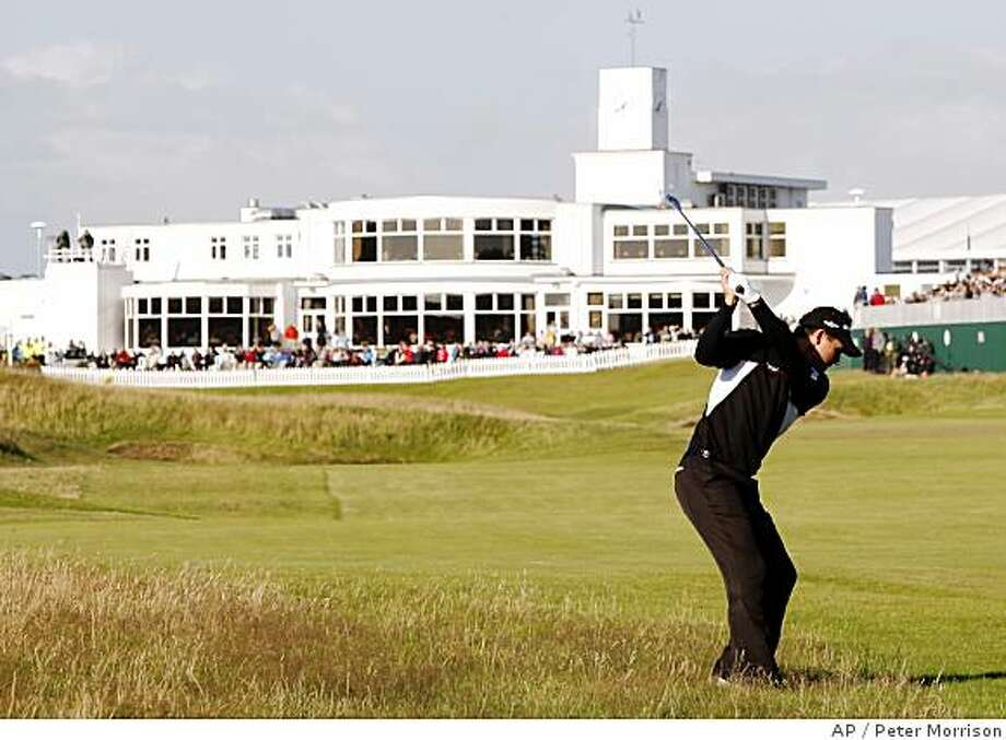 Padraig Harrington of Ireland plays his second shot to the 18th green during the third round of the British Open Golf championship, at the Royal Birkdale golf course, Southport, England, Saturday, July 19, 2008. (AP Photo/Peter Morrison) Photo: Peter Morrison, AP