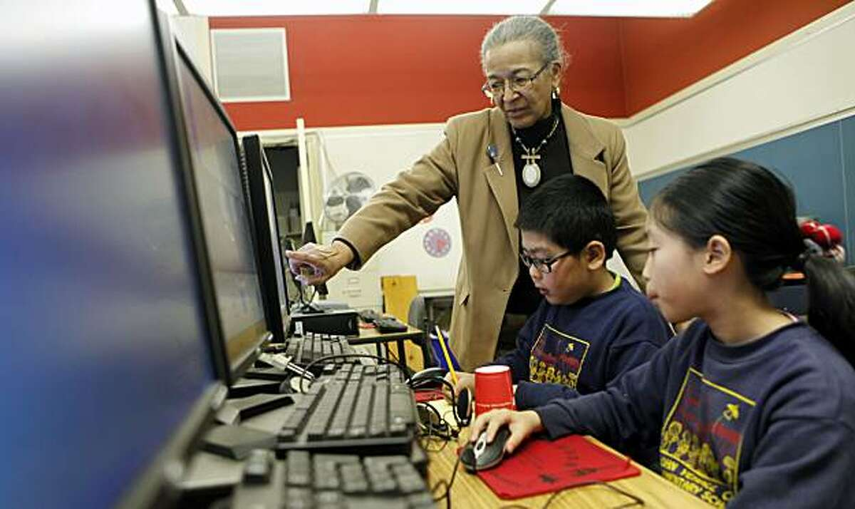 Earl Lene De Santiago monitors her 4th graders at John Yehall Chin Elementary School in San Francisco during computer lab. De Santiago along with her teachers union are angry over the state's new Race to the Top plan. Jan. 7, 2010