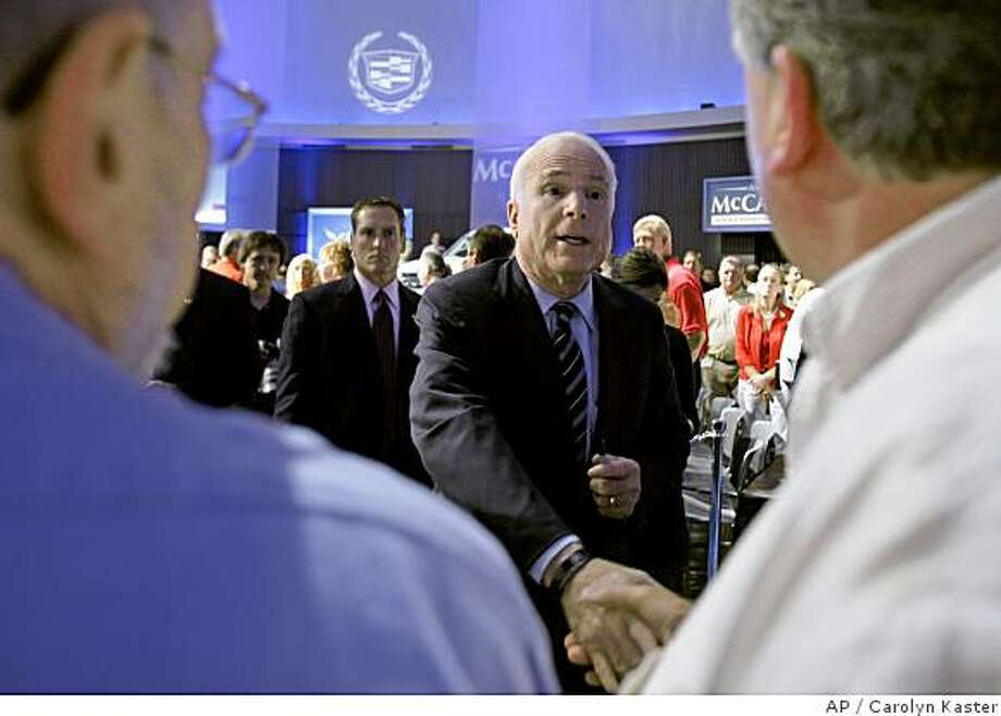Republican presidential candidate Sen. John McCain, R-Ariz. greets audience members as he makes a campaign stop a the General Motors Technical Center in Warren, Mich., Friday, July 18, 2008. (AP Photo/Carolyn Kaster) Photo: Carolyn Kaster, AP