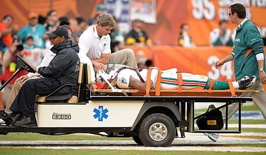 Miami Dolphins back-up quarterback Pat White is carted off the field after taking a big hit in the third quarter against the Pittsburgh Steelers. The Steelers defeated the Dolphins, 302-4 at Land Shark Stadium in Miami, Florida, Sunday, January 3, 2010. (Robert Duyos/Sun Sentinel/MCT) Photo: Robert Duyos, MCT
