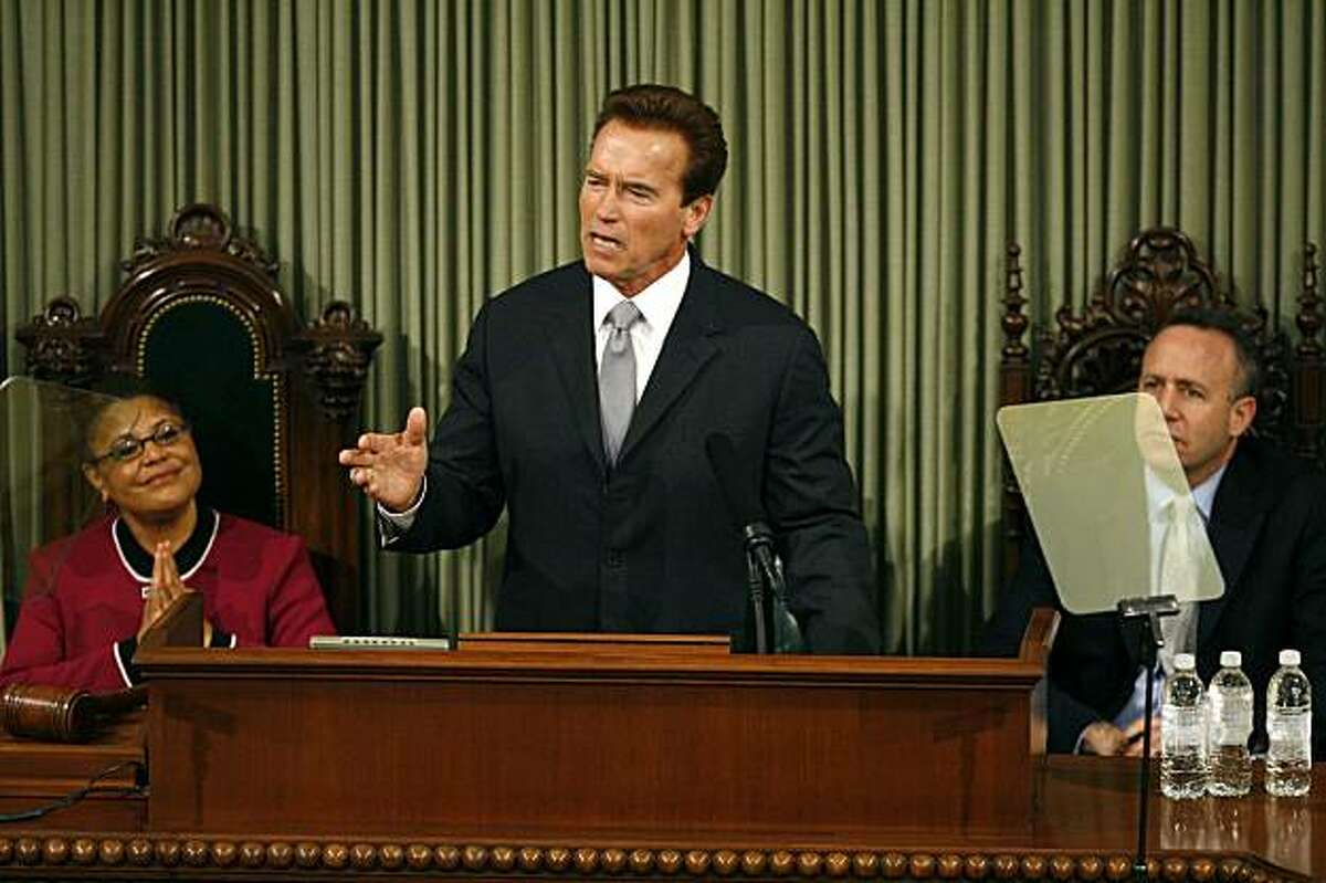 Gov. Arnold Schwarzenegger, center, delivers his final State of the State address at the Capitol in Sacramento, Calif. on Wednesday, Jan. 6, 2010. At the left is Assembly Speaker Karen Bass, D-Los Angeles, and Senate President Pro Tem Darrell Steinberg, D-Sacramento, at the right.