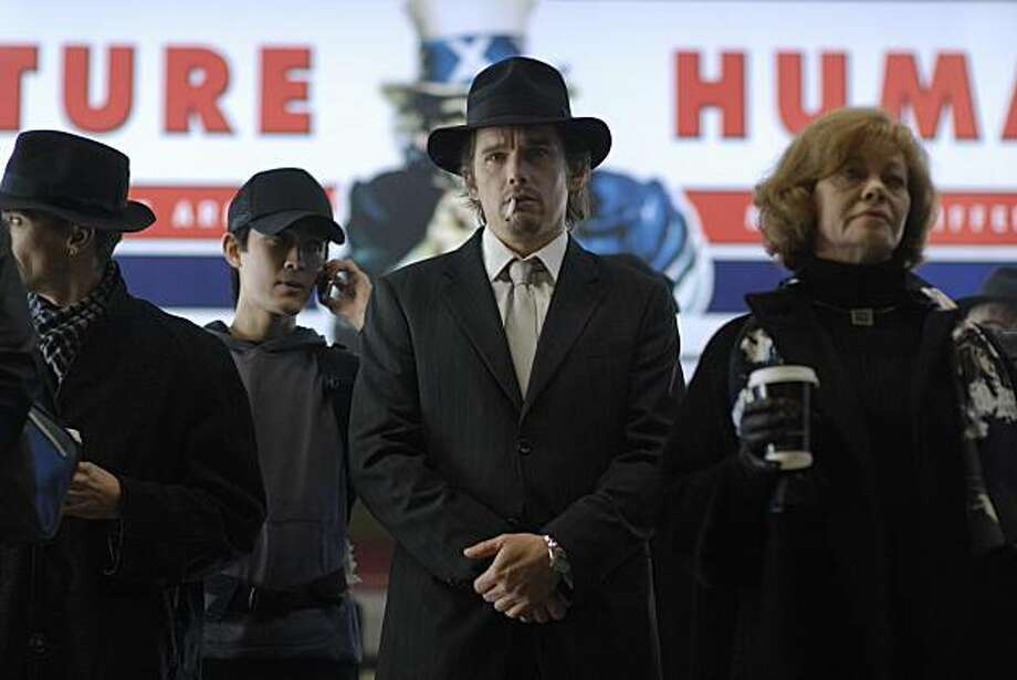 "In this film publicity image released by Lionsgate, Ethan Hawke, center, is shown in a scene from, ""Daybreakers.""   (AP Photo/Lionsgate, Ben Rothstein) Photo: Ben Rothstein, AP"