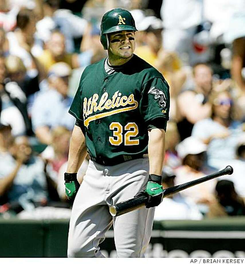 Oakland Athletics' Jack Cust walks back to the dugout after striking out during the sixth inning of a baseball game against the Chicago White Sox in Chicago, Sunday, July 6, 2008. (AP Photo/Brian Kersey) Photo: BRIAN KERSEY, AP