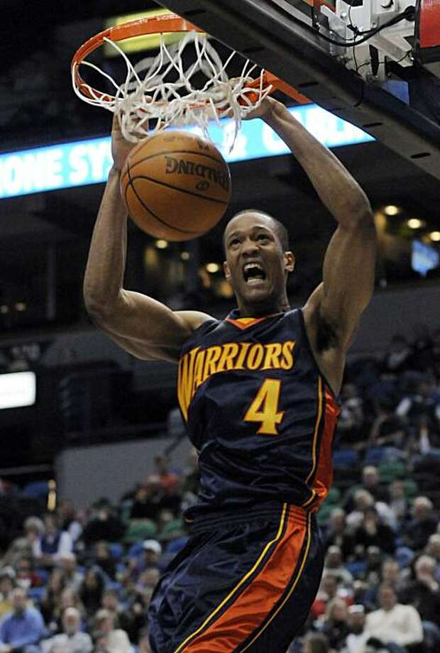 Golden State Warrior's Anthony Randolph dunks against the Minnesota Timberwolves in the second half of an NBA basketball game Wednesday, Jan. 6, 2010 in Minneapolis. Randolph scored 15 points in the Warrior's 107-101 win. Photo: Jim Mone, AP