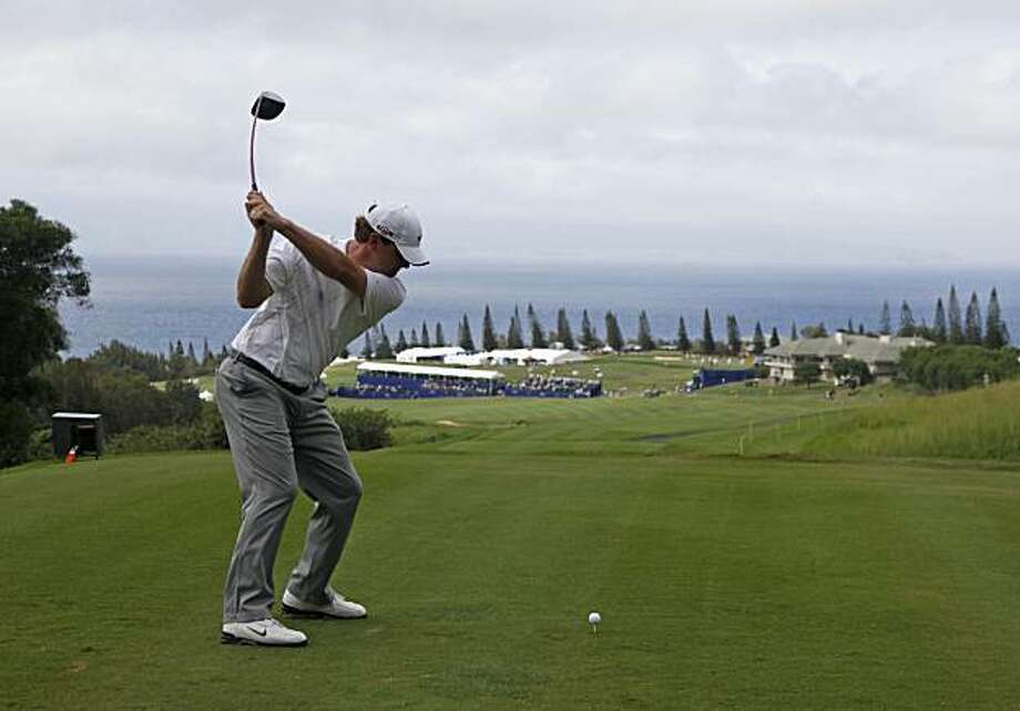 Lucas Glover hits from the 18th tee during the first round of the SBS Championship golf tournament in Kapalua, Hawaii, Thursday, Jan. 7, 2010.  Glover shot a 7-under-par 66. Photo: Eric Risberg, AP