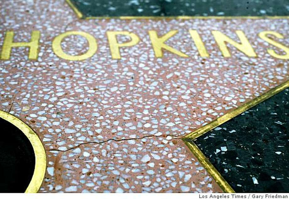 AGING UNGRACEFULLY: The black terrazzo stone on the walk is warping, and the pink stars are cracking. -- PHOTOGRAPHER: Gary Friedman Los Angeles Times Gary Friedman -- - 071953.me.1010.fame1.gf The Hollywood Walk of Fame is mysteriously buckling: the black terrazzo stone surrounding the pink stars is pouching up, sometimes at night. Fissures seem to be opening up in the pink stars themselves more quickly than ever before. The star of Anthony Hopkins, installed last month, already has a tiny crack. Photo: Gary Friedman, Los Angeles Times