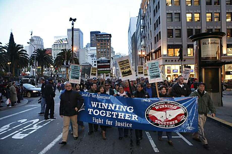 A crowd moves through Union Square in San Francisco, Calif., during a march by unionized hotel workers Tuesday, January 5, 2009, including AFL-CIO President Richard Trumka, as part of a civil disobedience that launched a boycott of the Hilton San Francisco. Members of Unite Here Local 2 have staged a series of walkouts and boycotts since their contract expired in August. The union has sought to retain generous health care coverage while management has insisted that the San Francisco workers shoulder more costs. Photo: Carlos Avila Gonzalez, The Chronicle