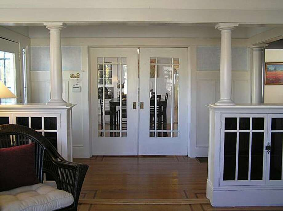 A look at the pocket doors in the foyer, which open to the dining room, from the living room. The living room adjoins the foyer via a columned entry. Photo: Griselda Bissett