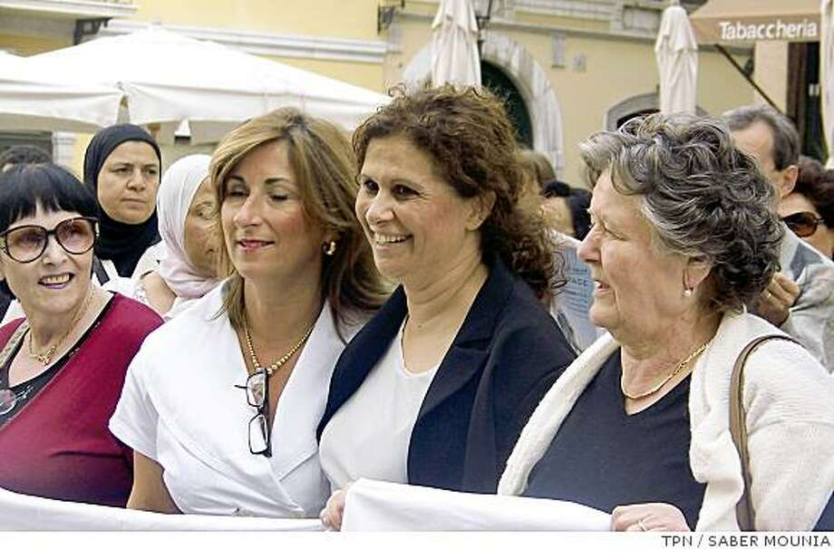 "Souad Sbai, second from right, is a Moroccan-born Italian lawmaker who is a champion of female Muslim immigrants in Italy. ""It is absurd that in a civilized country like Italy, so little is acknowledged about this,"" she said of the abuse some women face. Illustrates ITALY-POLYGAMY (category i) by Tracy Wilkinson (c) 2008, Los Angeles Times. Moved Friday, July 18, 2008. (MUST CREDIT: Photo for the Los Angeles Times by Saber Mounia.) Photo: TPN"