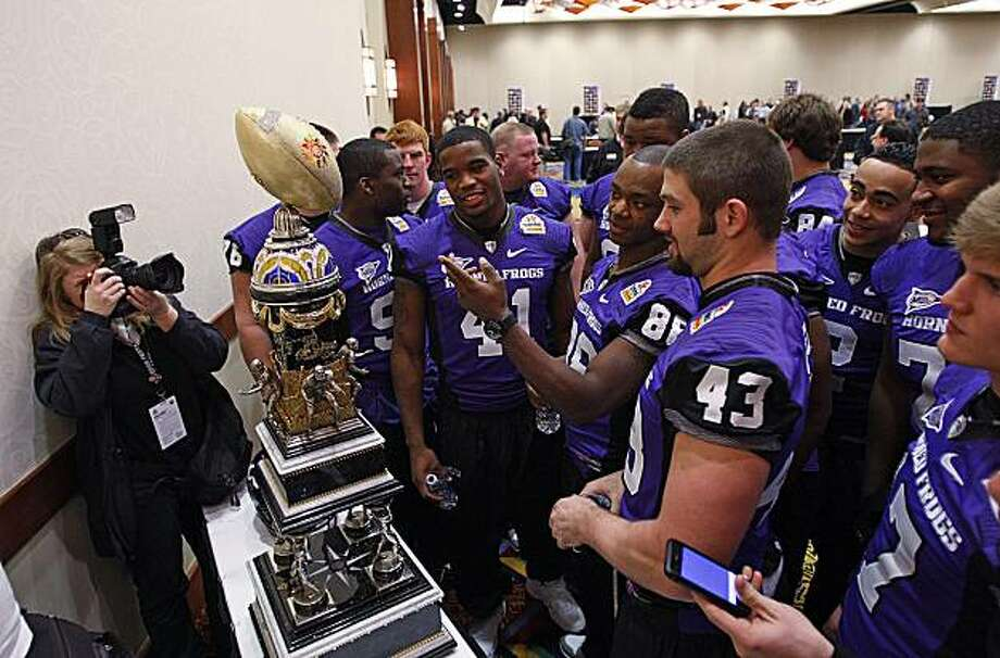 Several TCU starters gather to look at the Tostitos Fiesta Bowl trophy during media day for the Fiesta Bowl at the Camelback Inn in Scottsdale, Arizona, Friday, January 1, 2010. TCU will face Boise State in the BSC bowl game. (Rodger Mallison/Fort Worth Star-Telegram/MCT) Photo: Rodger Mallison, MCT