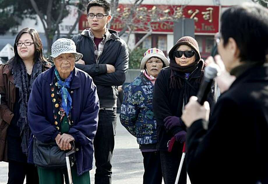 A small crowd gathered as Anni Chung (right) urged cooperation with the census people. The United States Census Bureau's rolling effort to convince people in historically undercounted areas to cooperate with the count made an appearance in Chinatown's Portsmouth Square Tuesday January 5, 2009. Photo: Brant Ward, The Chronicle
