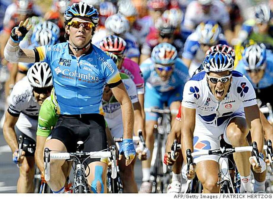 Britain's Mark Cavendish (L) (Columbia -ex-High Road/US) jubilates on the finish line, on July 17, 2008, at the end of the 168,5 km twelfth stage of the 2008 Tour de France cycling race run between Lavelanet and Narbonne. Britain's Mark Cavendish (Columbia -ex-High Road/US) won ahead of French Sebastien Chavanel (R) (La Francaise des Jeux/Fra) and Belgian Gert Steegmans (Quick Step/Bel). AFP PHOTO PATRICK HERTZOG (Photo credit should read PATRICK HERTZOG/AFP/Getty Images) Photo: PATRICK HERTZOG, AFP/Getty Images