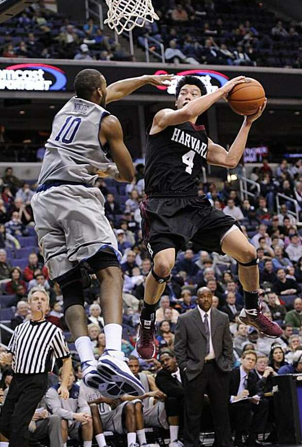 Harvard's Jeremy Lin (4) goes to the basket as Georgetown's Greg Monroe (10) defends during the first half of an NCAA college basketball game, Wednesday, Dec. 23, 2009, in Washington.(AP Photo/Nick Wass) Photo: Nick Wass, AP