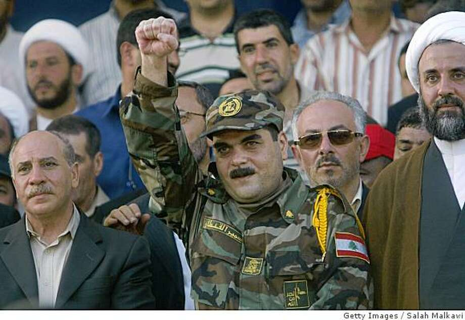 NAQOURA, LEBANON - JULY 16:  Freed Lebanese prisoner Samir Qantar greets the crowd upon his arrival from an Israeli prison as Hezbollah prepare to receive the bodies of 200 soldiers, during an exchange of prisoners with Israel on July 16, 2008 in Naqoura, Lebanon. Israel returned five Lebanese prisoners and the bodies of 200 Lebanese and Palestinian fighters in return for the bodies of the two Israeli soldiers, who's capture sparked the war of 2006. The exchange was engineered by the Red Cross.  (Photo by Salah Malkawi/Getty Images) Photo: Getty Images