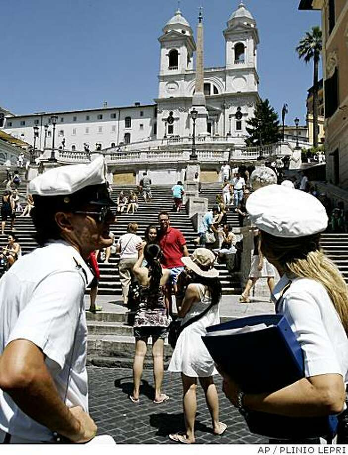 Rome's municipal police officers patrol in front of the Spanish Steps in downtown Rome, Italy, Wednesday, July 16, 2008, after City Hall banned the eating of snacks too close to famous monuments in Rome's historical center.  The local law is placed to help preserve artistic treasures in the city and will be effective through the summer, with offenders facing a possible euro50 (US$80) fine. (AP Photo/Plinio Lepri) Photo: PLINIO LEPRI, AP
