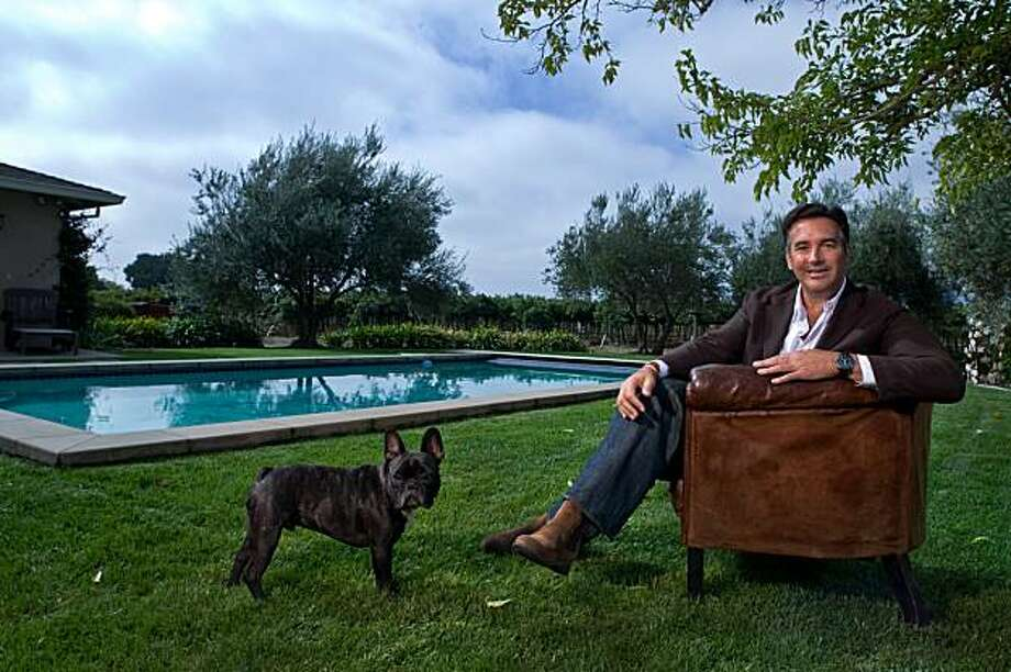 Michael Polenske, founder of Blackbird Winery with his dog Oliver pool side at his home in Napa, California on Oct. 9, 2009. Photo: Peter DaSilva, Special To The Chronicle