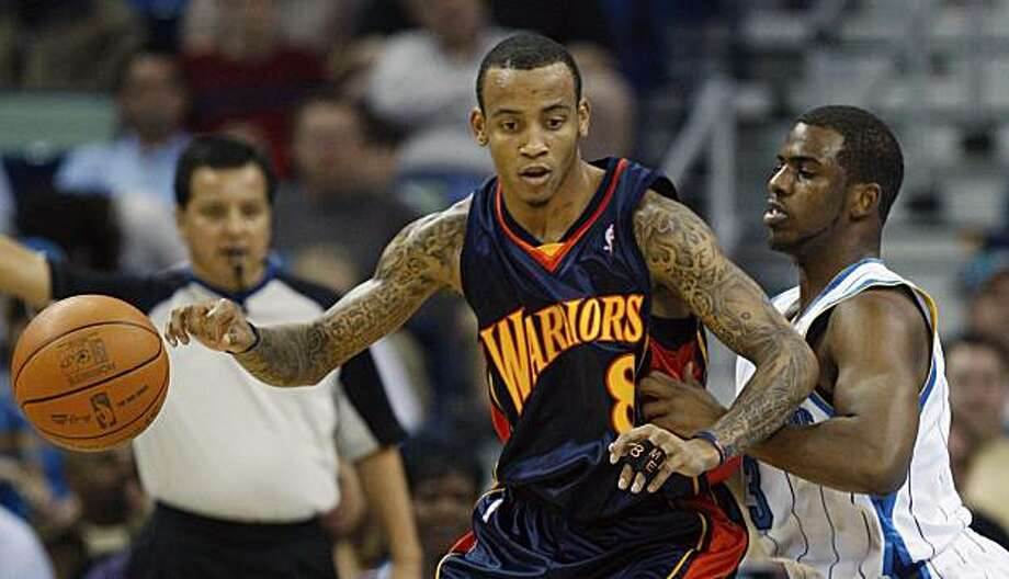 Golden State Warriors guard Monta Ellis (8) loses the ball in front of New Orleans Hornets guard Chris Paul (3) in the first half of an NBA basketball game in New Orleans, Wednesday, Dec. 23, 2009. (AP Photo/Bill Haber) Photo: Bill Haber, AP