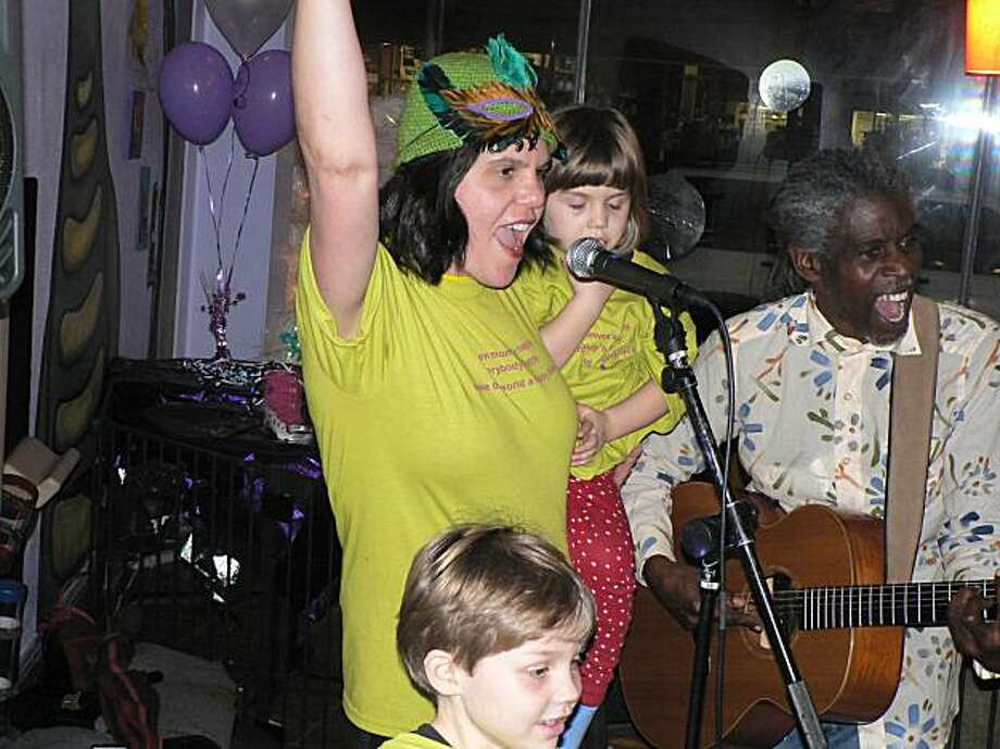 Susan Older-Mondeel, owner of SadieDeys's Cafe in Oakland (with Deylan and Sadie Mondeel), with Asheba (right) at last year's New Year's Eve party. The group returns for tonight's fourth annual bash. Photo: Courtesy Susan Older-Mondeel