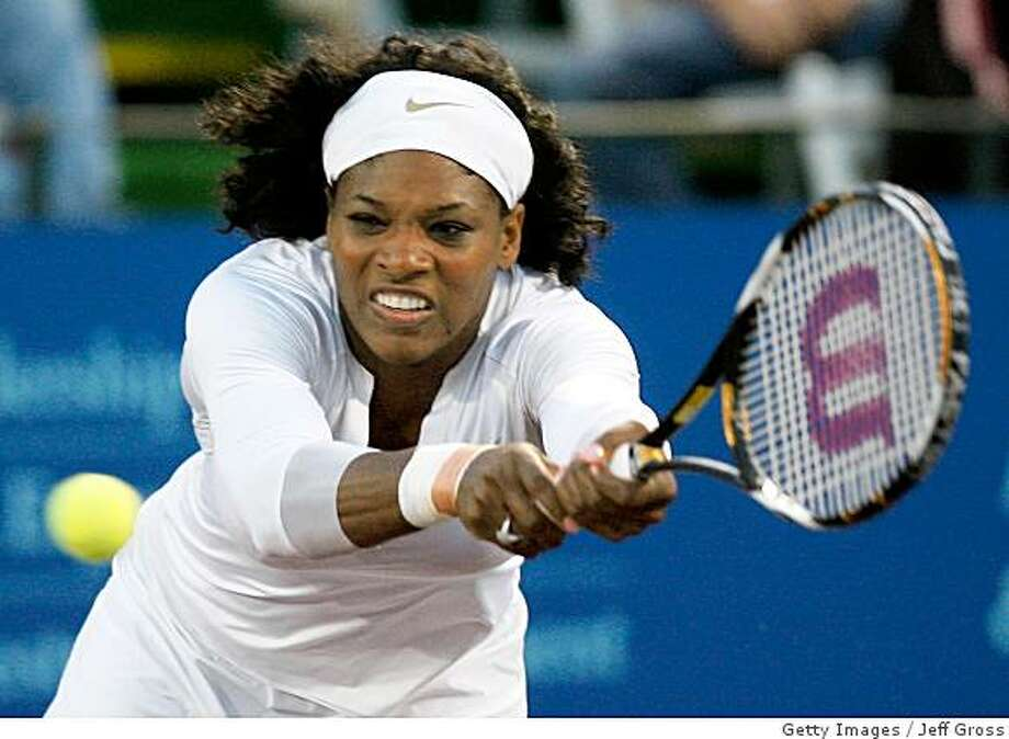 Serena Williams reaches for a backhand during a mixed doubles match at the game at Breakers Stadium at the Newport Beach Country Club on July 13, 2008 in Newport Beach, California. Photo: Getty Images