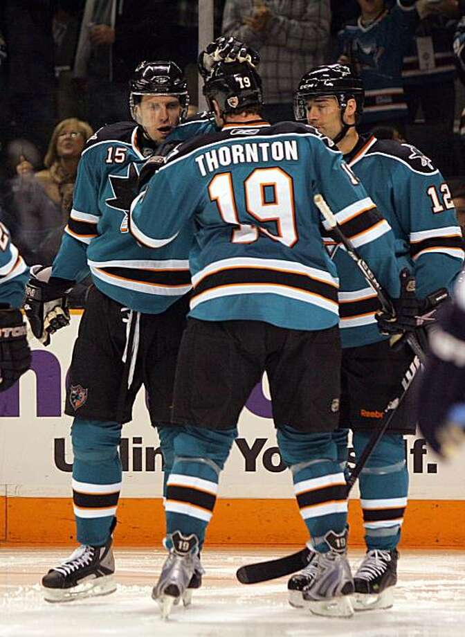 SAN JOSE, CA - JANUARY 02:  Joe Thornton #19 and Patrick Marleau #12 of the San Jose Sharks congratulate Dany Heatley #15 after Heatley scored a goal in the second period against the Edmonton Oilers at HP Pavilion on January 2, 2010 in San Jose, California.  (Photo by Ezra Shaw/Getty Images) Photo: Ezra Shaw, Getty Images