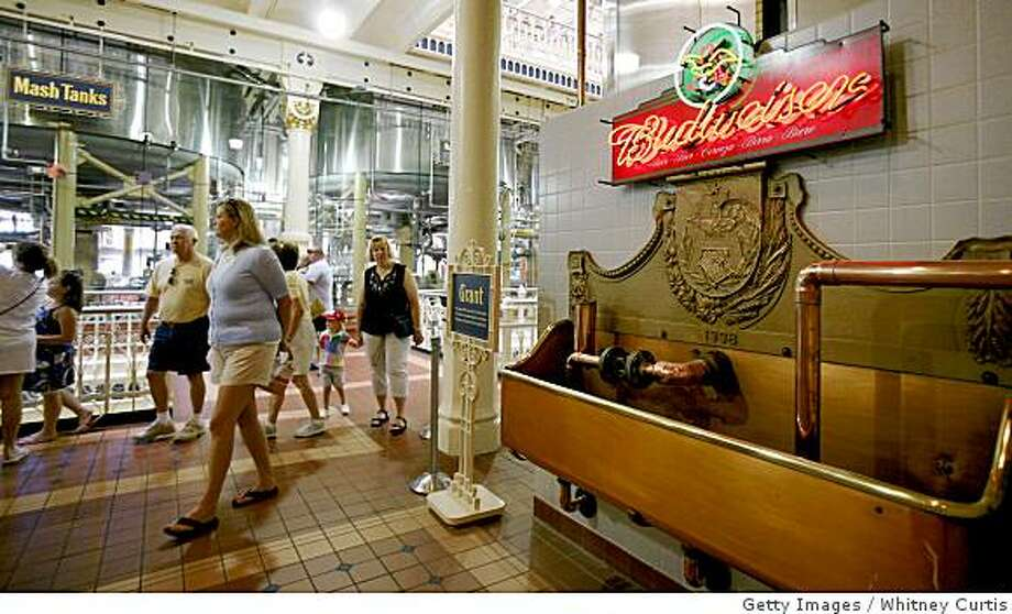ST. LOUIS, MO - JULY 14:  Visitors tour the brewhouse for Anheuser-Busch Cos. July 14, 2008 in St. Louis, Missouri. Anheuser-Busch Cos. Inc.'s board of directors voted Sunday to accept Belgian brewer InBev's takeover offer of $52 billion. (Photo by Whitney Curtis/Getty Images) Photo: Whitney Curtis, Getty Images