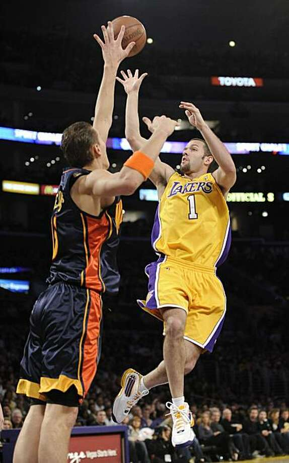 Los Angeles Lakers guard Jordan Farmar (1) shoots over Golden State Warriors center Andris Biedrins, of Latvia, left, in the second half of an NBA basketball game, Tuesday, Dec. 29, 2009, in Los Angeles. The Lakers won 124-118. (AP Photo/Gus Ruelas) Photo: Gus Ruelas, AP