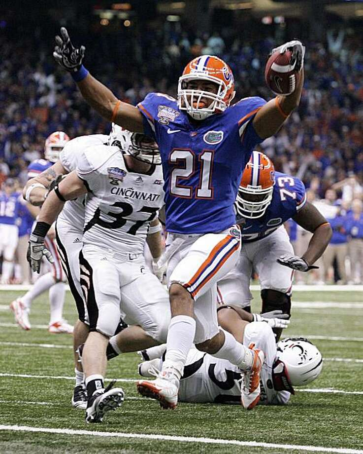 Florida running back Emmanuel Moody (21) reacts as he scores in the first half of the Sugar Bowl NCAA college football game in New Orleans, Friday, Jan. 1, 2010. Defending for Cincinnati is JK Schaffer (37).  (AP Photo/Patrick Semansky) Photo: Patrick Semansky, AP