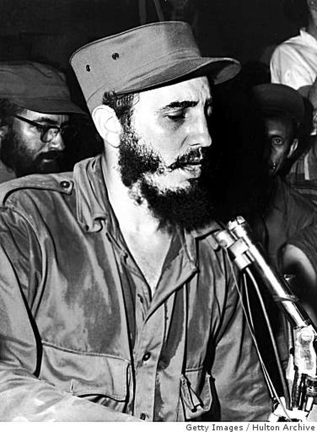 CAMAGUEY, CUBA: (FILE PHOTO) circa 1959: Cuban communist leader Fidel Castro, wearing military fatigues, sits in front of a microphone while speaking to the people of Camaguey, Cuba. It has been reported that Fidel Castro has resigned as Cuban president after being in power for several decades. He was first sworn in on December 2, 1976 but due to illness recently transferred his duties to his younger brother Raul Modesto Castro Ruz. (Photo by Hulton Archive/Getty Images)