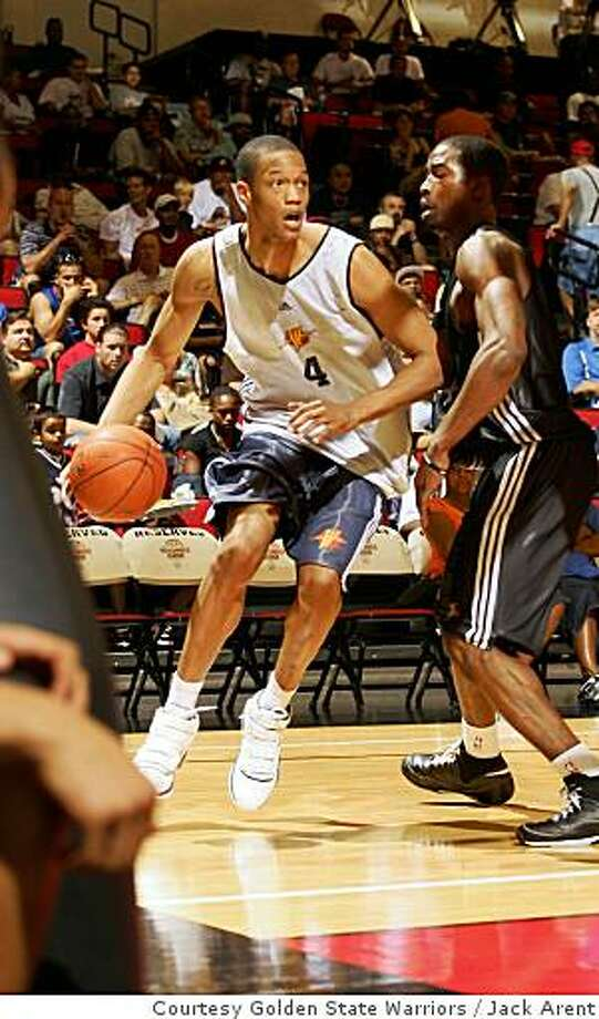 Anthony Randolph (left) of the Warriors plays against the 76ers' Thaddeus Young in a summer league game in Las Vegas on July 12, 2008. Photo: Jack Arent, Courtesy Golden State Warriors