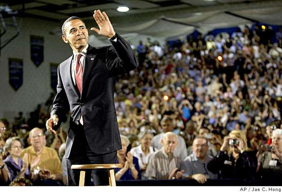 Democratic presidential candidate, Sen. Barack Obama, D-Ill., waves as he arrives for a town hall-style meeting in Fairfax, Va.,  Thursday, July 10, 2008. (AP Photo/Jae C. Hong) Photo: Jae C. Hong, AP