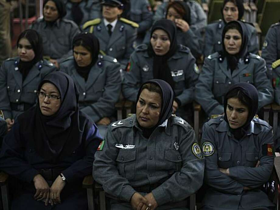 In this photo taken Dec. 17, 2009, Afghan policewomen attend a graduation ceremony after eight weeks of training at a police academy in Kabul, Afghanistan. Just about 500 Afghan women work as active duty officers, compared with about 92,500 policemen, most of them in relatively safe areas like Kabul and northern Herat province, according to Interior Ministry figures. The government has a target of 5,000 women serving as officers or civilian police workers by 2014. (AP Photo/Dusan Vranic) Photo: Dusan Vranic, AP