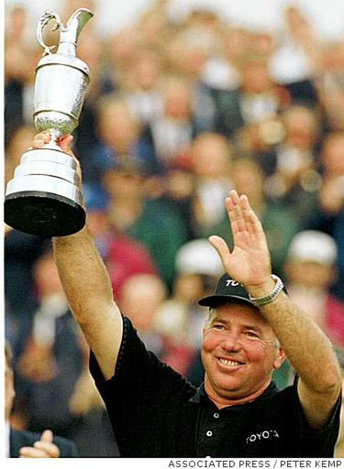Mark O'Meara from the USA holds up the cup on the18th green, Sunday, July 19, 1998 at Royal Birkdale Golf Club, in Southport, in North West England after winning the 1998 British Open Golf Championships. Photo: PETER KEMP, ASSOCIATED PRESS