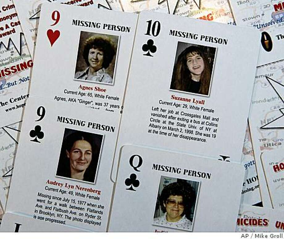 **APN ADVANCE FOR SUNDAY JULY 13**  Cold case playing cards are seen in Ballston Spa, N.Y., Wednesday, May 7, 2008.  Doug Lyall's latest attempt to learn the fate of his missing daughter, Suzanne Lyall, and help others locate long missing people and unravel unsolved murders lies in a deck of customized poker cards that are being distributed to inmates in county jails throughout New York.  Each of the 52 cards feature a different case and come with a photo and a short narrative.  (AP Photo/Mike Groll) Photo: Mike Groll, AP