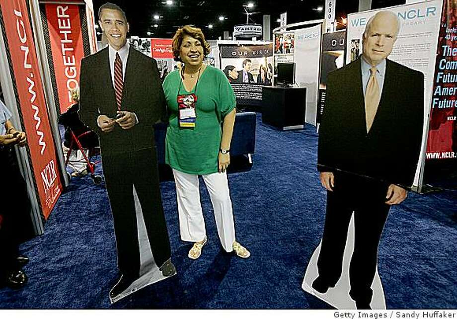 SAN DIEGO, CA - JULY 13:  Maria Garcia has her portrait taken with a cut-out image of  Presumptive Demcoratic presidential nominee Barack Obama at the National Council of La Raza Annual Meeting on July 13, 2008 in San Diego, California. The NCLR is the largest Hispanic Civil rights and advocacy organization in the United States and works to opportunities for Hispanic Americans.(Photo by Sandy Huffaker/Getty Images) Photo: Sandy Huffaker, Getty Images