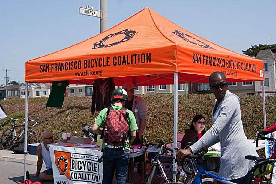 SF Bicycle Coalition volunteer Riyad Ghannam talks to participants of last year's Sunday Streets event along the Great Highway.  SONY DSC Photo: San Francisco Bicycle Coalition