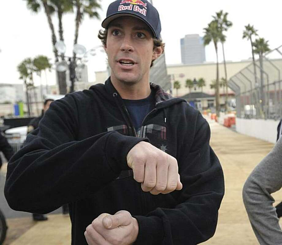 Travis Pastrana describes how he controls his car in the air, Wednesday, Dec. 30, 2009, in Long Beach, Calif. Pastrana is scheduled to attempt on Thursday to set a world record for the longest jump in a rally car, from the Pine Street Pier onto a barge anchored in the harbor. (AP Photo/Long Beach Press-Telegram, Jeff Gritchen) ** MAGS OUT ** Photo: Jeff Gritchen, AP
