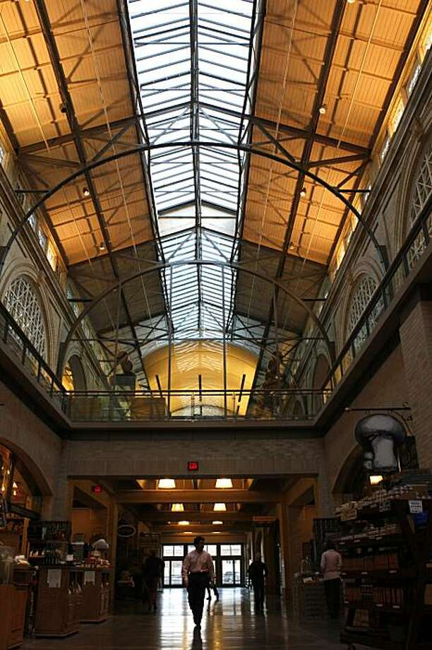 It has been five years since San Francisco's Ferry Building has been redeveloped. The ground level now features retail shops, while the second level displays a new modern look to its facade. Photo: Deanne Fitzmaurice, The Chronicle