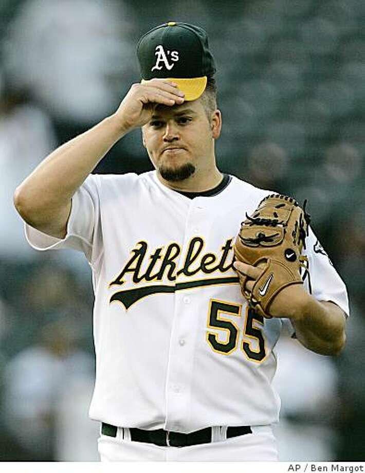 Oakland Athletics' Joe Blanton adjusts his cap during the first inning of a baseball game against the Philadelphia Phillies, Tuesday, June 24, 2008, in Oakland, Calif. (AP Photo/Ben Margot) Photo: Ben Margot, AP