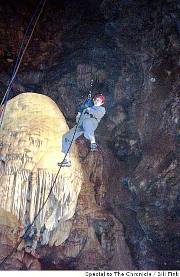 "pic 1: ""Bacon Strip"" drapery formation created by iron oxide mixed with calcite drippings over millions of years pic 2: Adventure Tour leader at Moaning Cavern begins the 165 foot rappel Photo: Bill Fink, Special To The Chronicle"